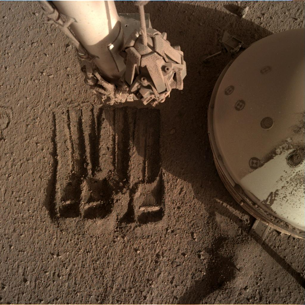 Nasa's Mars lander InSight acquired this image using its Instrument Deployment Camera on Sol 867