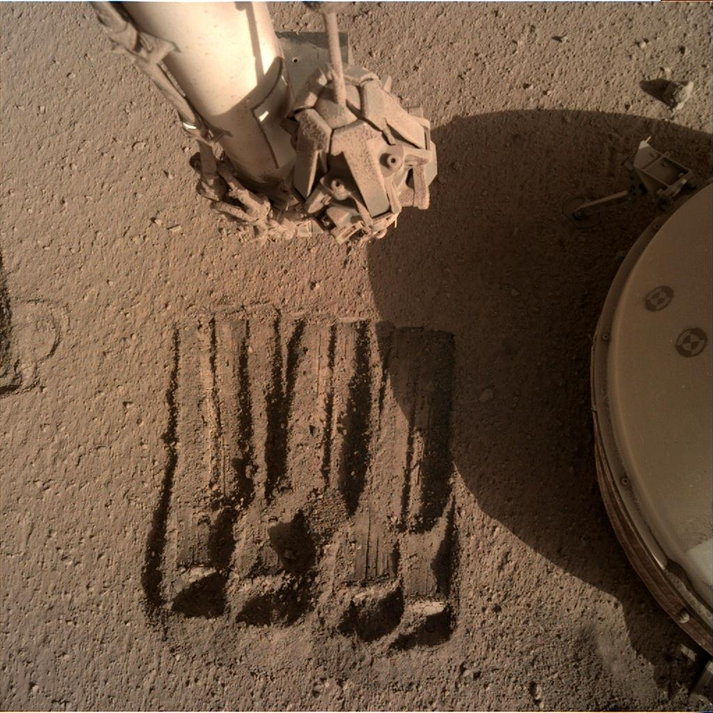 Nasa's Mars lander InSight acquired this image using its Instrument Deployment Camera on Sol 870