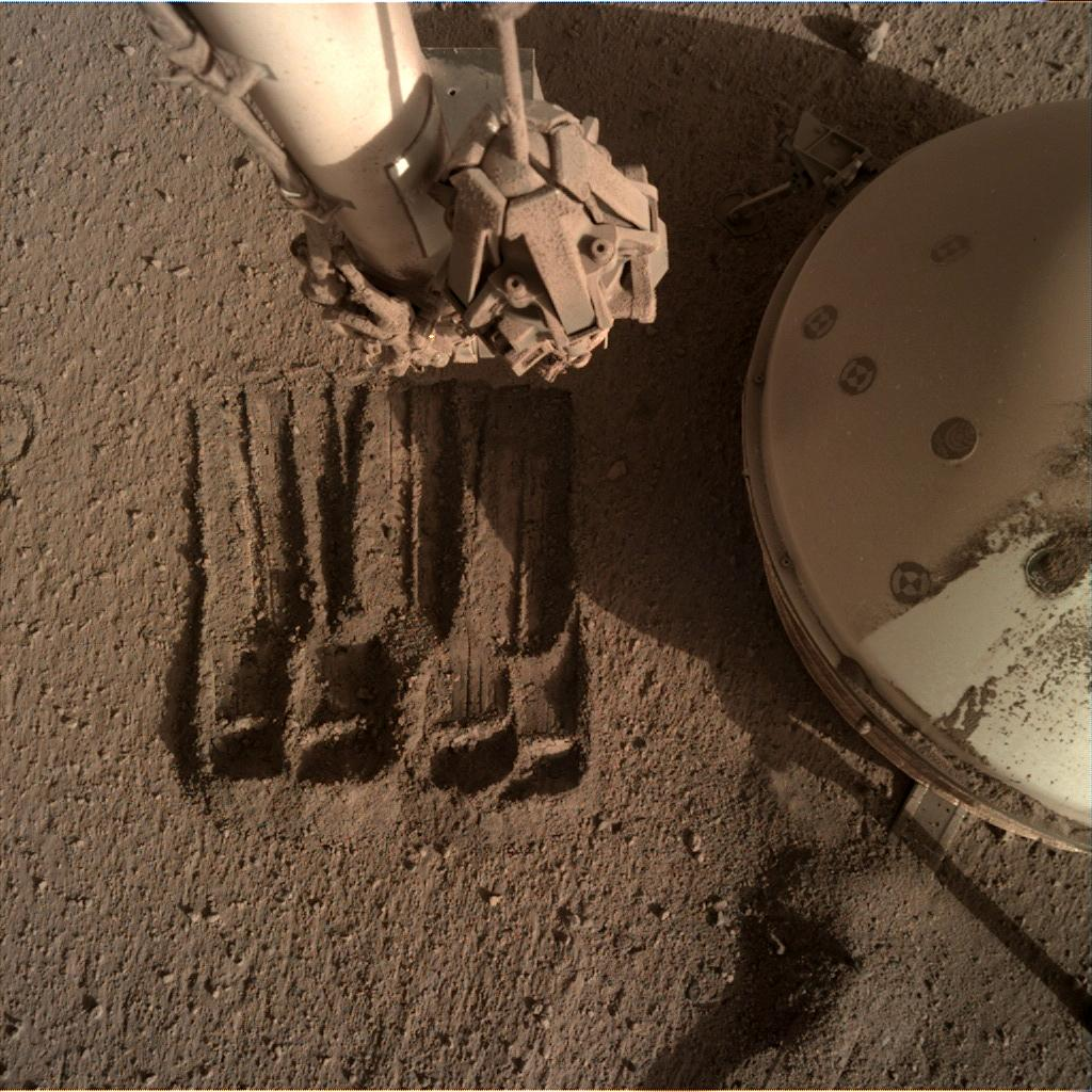 Nasa's Mars lander InSight acquired this image using its Instrument Deployment Camera on Sol 875
