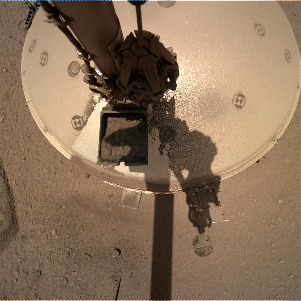 Nasa's Mars lander InSight acquired this image using its Instrument Deployment Camera on Sol 877