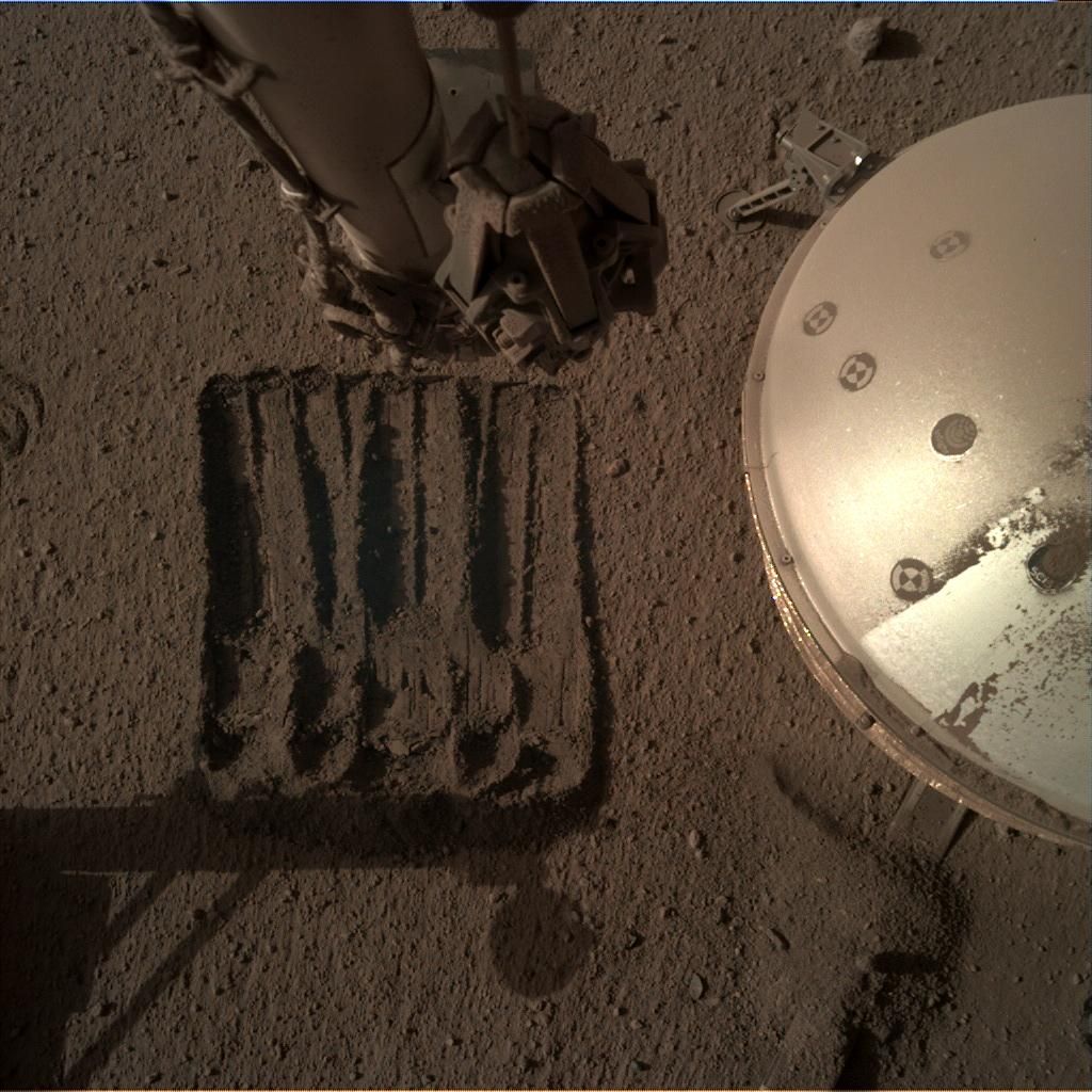 Nasa's Mars lander InSight acquired this image using its Instrument Deployment Camera on Sol 878