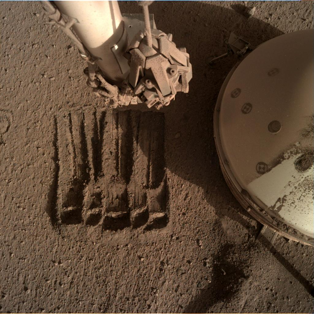 Nasa's Mars lander InSight acquired this image using its Instrument Deployment Camera on Sol 882