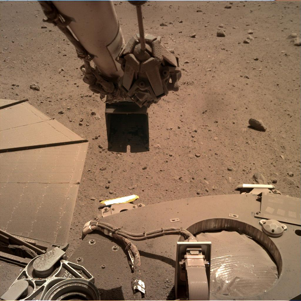 Nasa's Mars lander InSight acquired this image using its Instrument Deployment Camera on Sol 884