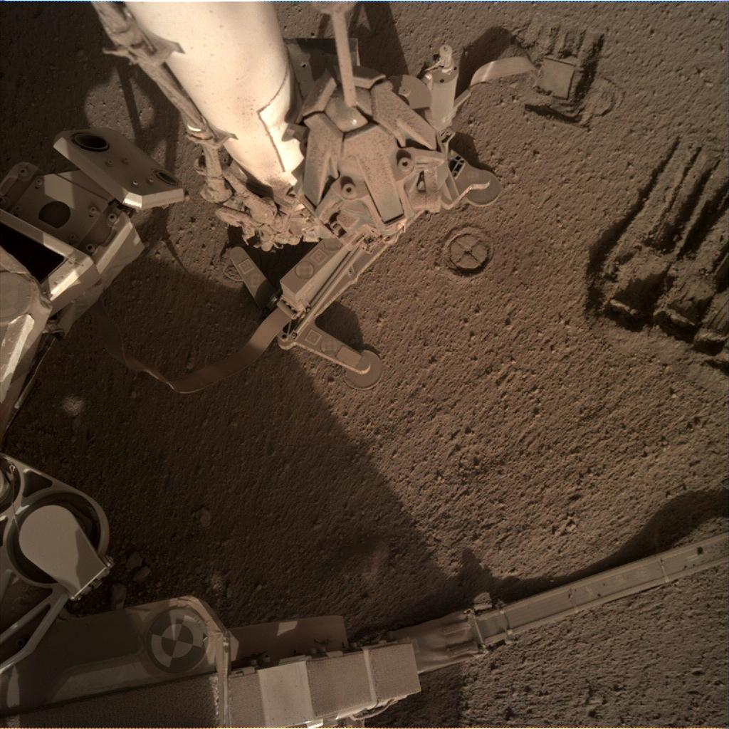Nasa's Mars lander InSight acquired this image using its Instrument Deployment Camera on Sol 885