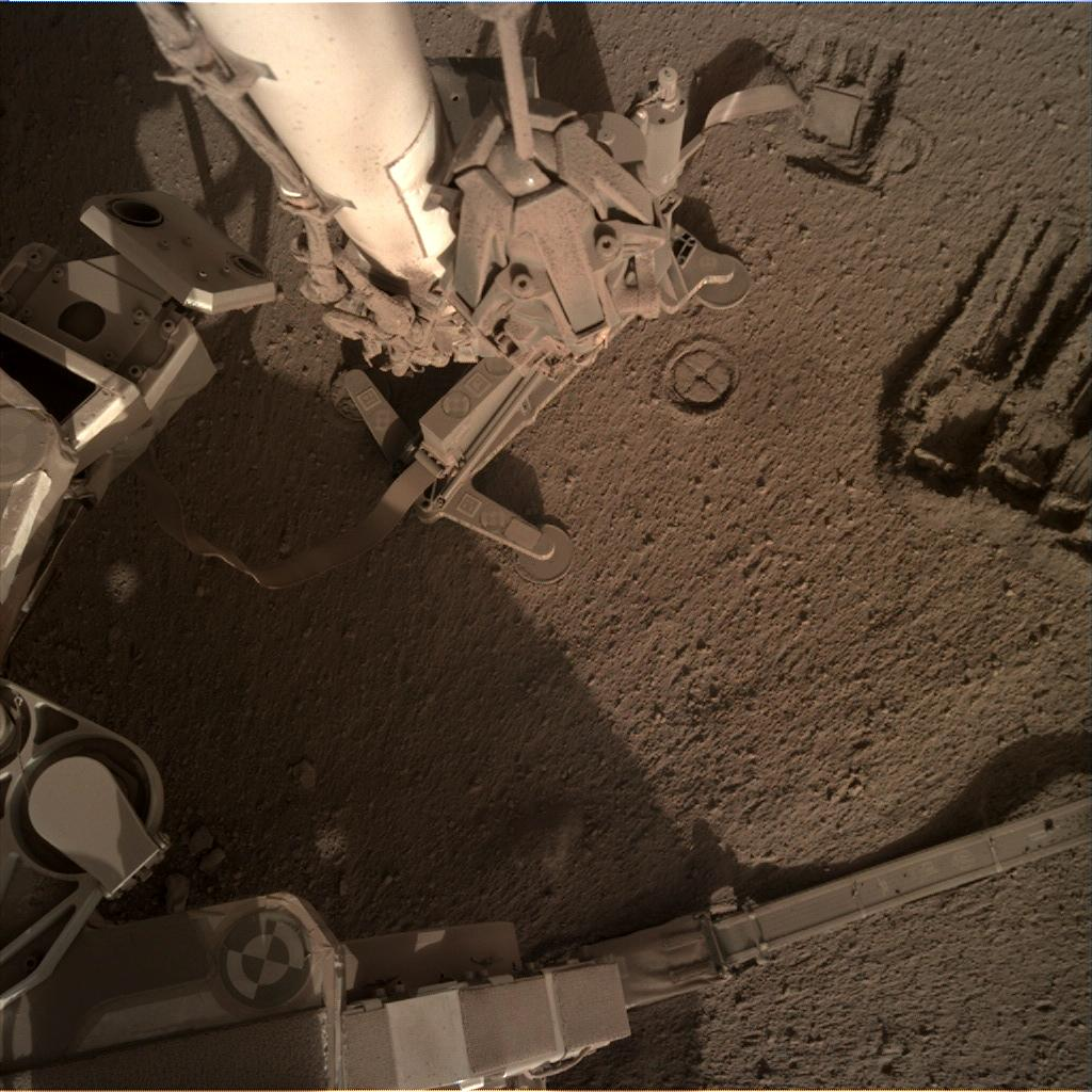 Nasa's Mars lander InSight acquired this image using its Instrument Deployment Camera on Sol 889