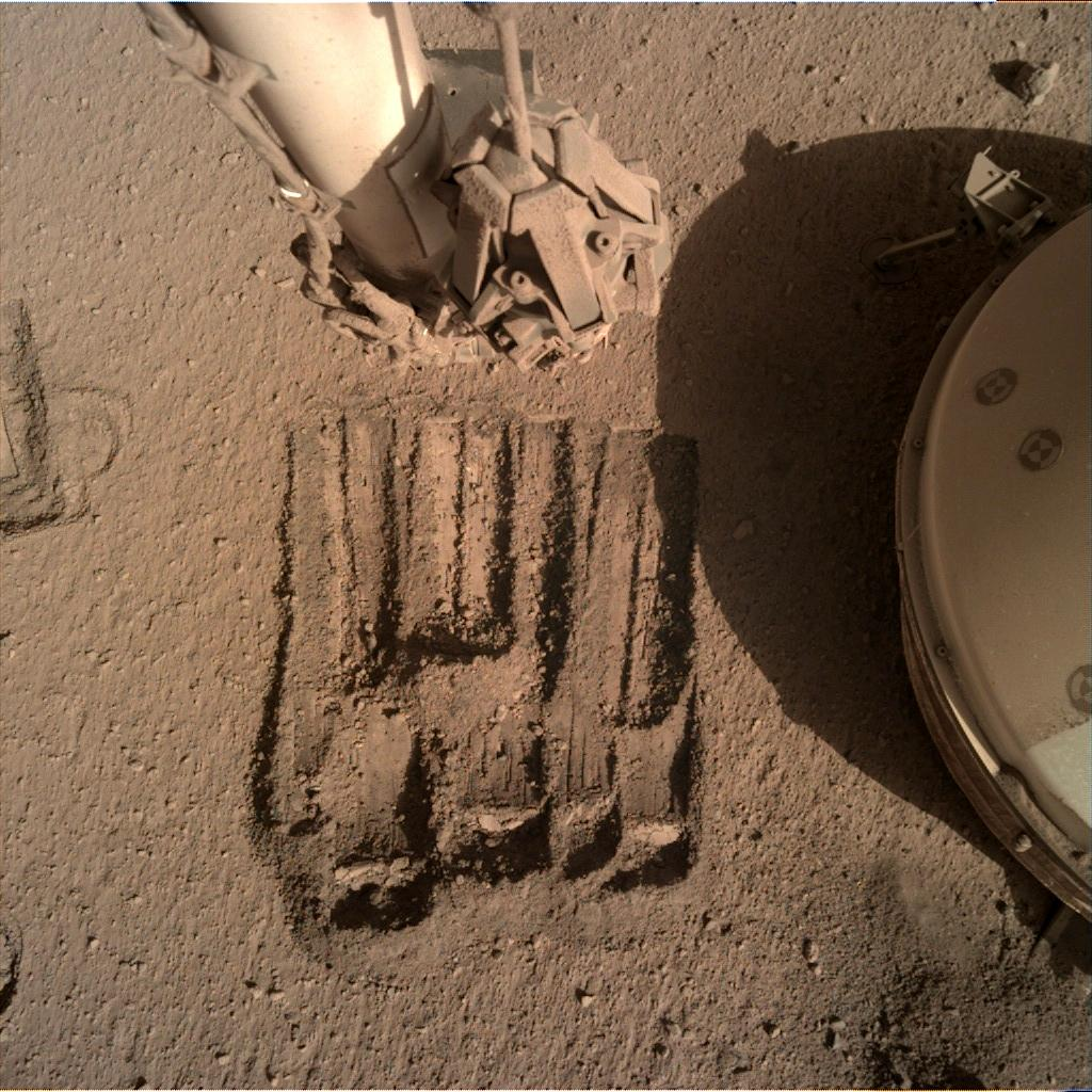 Nasa's Mars lander InSight acquired this image using its Instrument Deployment Camera on Sol 891