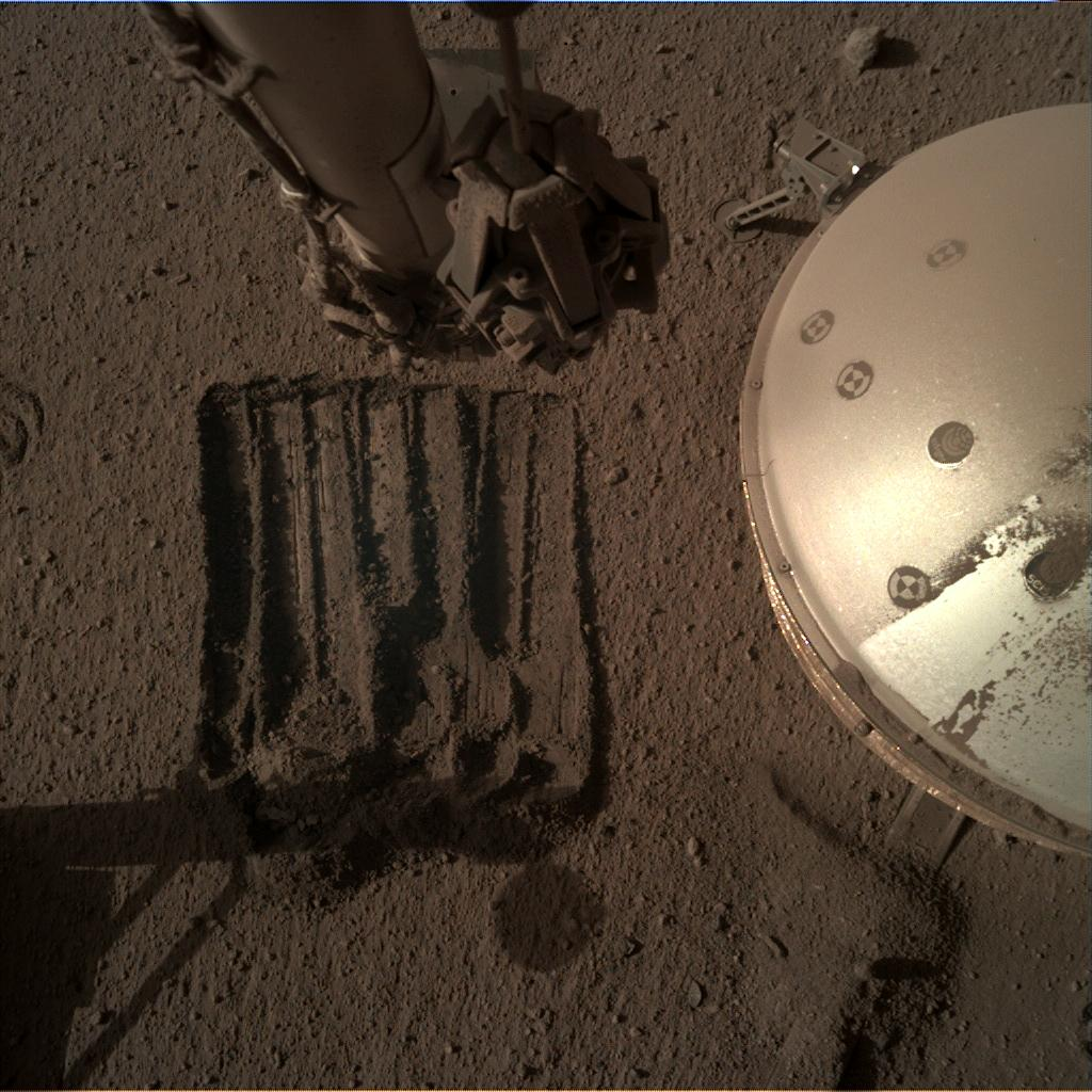 Nasa's Mars lander InSight acquired this image using its Instrument Deployment Camera on Sol 892