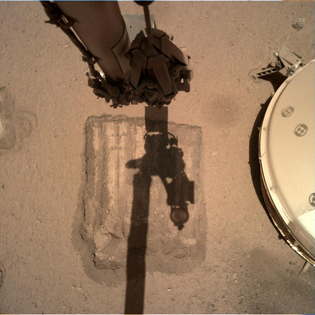 Nasa's Mars lander InSight acquired this image using its Instrument Deployment Camera on Sol 897