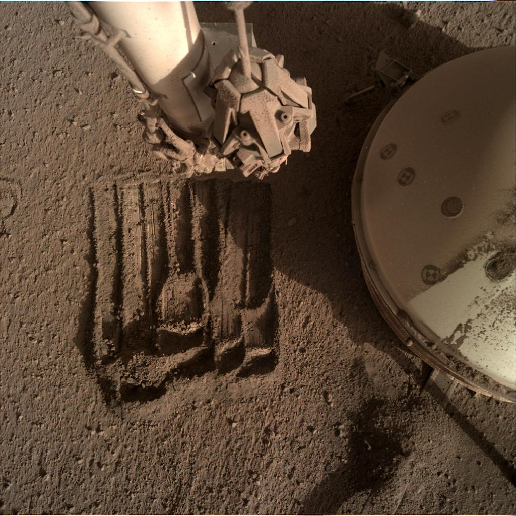 Nasa's Mars lander InSight acquired this image using its Instrument Deployment Camera on Sol 898