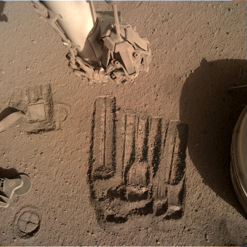 Nasa's Mars lander InSight acquired this image using its Instrument Deployment Camera on Sol 904