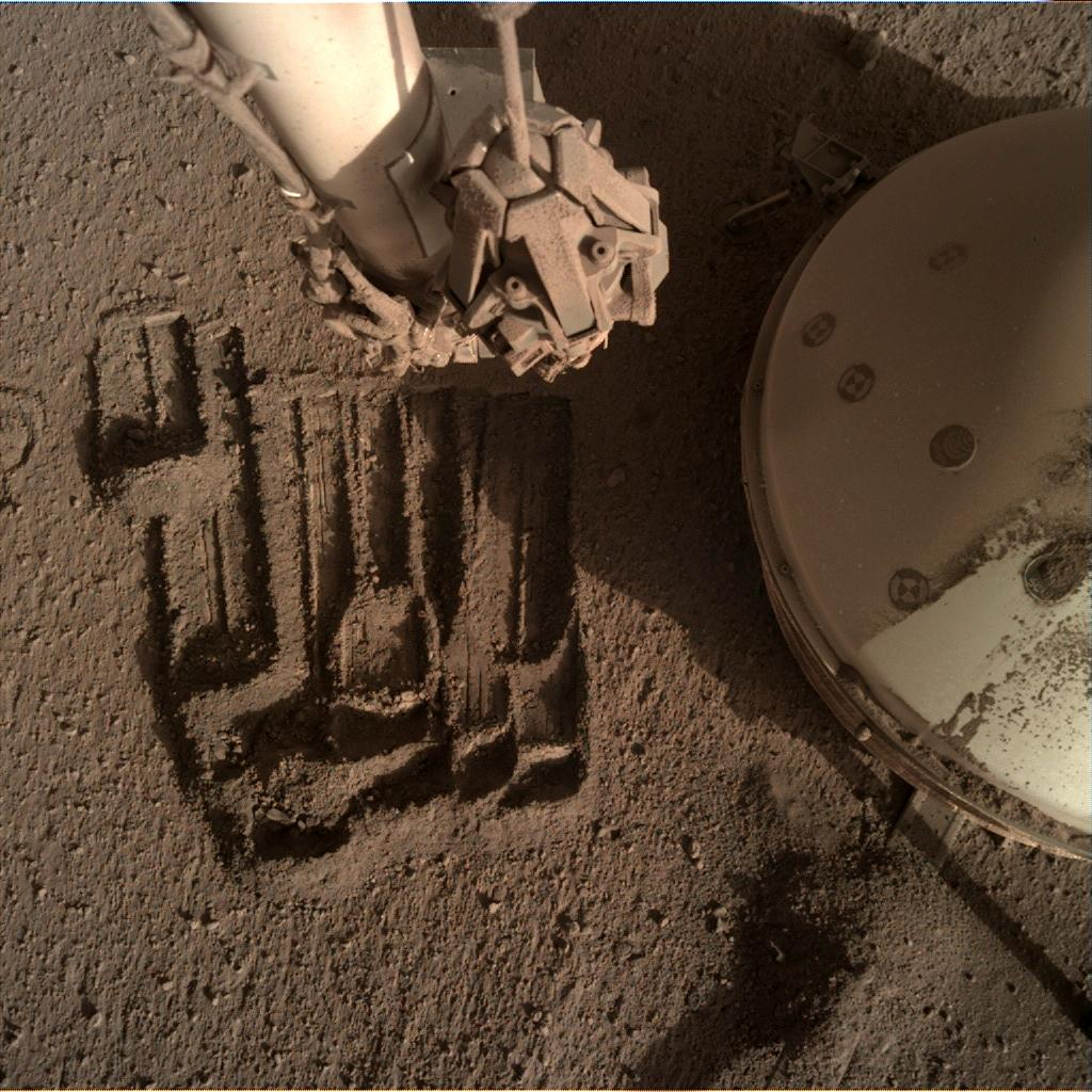Nasa's Mars lander InSight acquired this image using its Instrument Deployment Camera on Sol 908