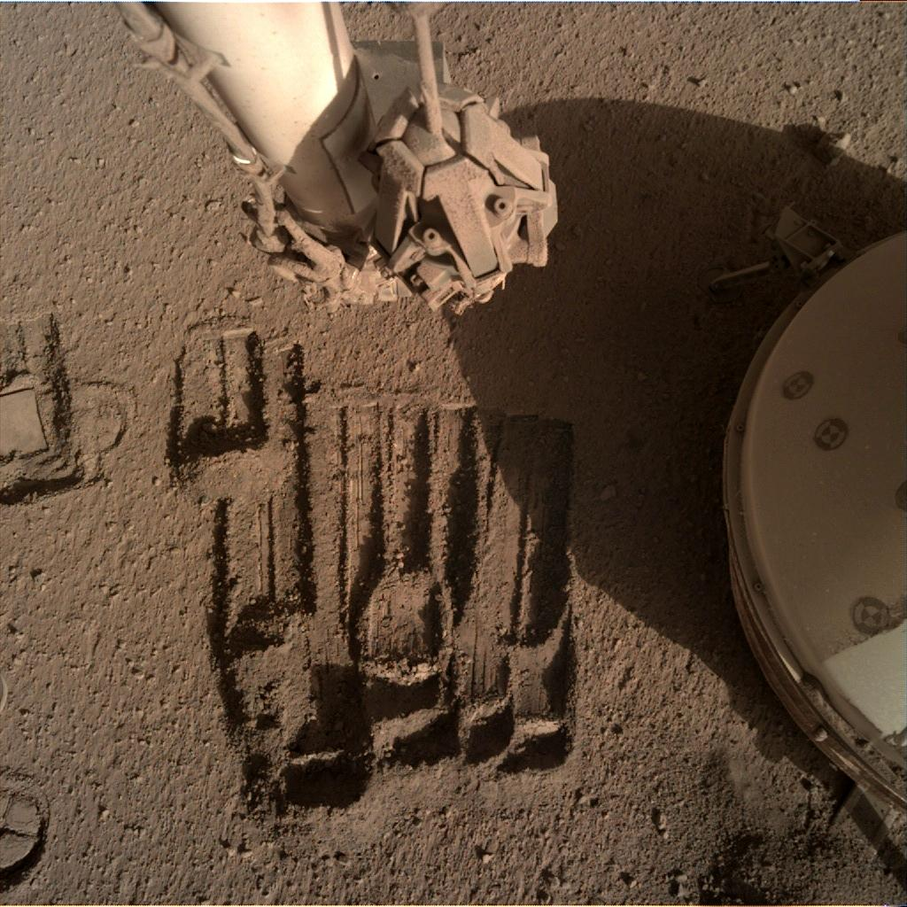 Nasa's Mars lander InSight acquired this image using its Instrument Deployment Camera on Sol 911