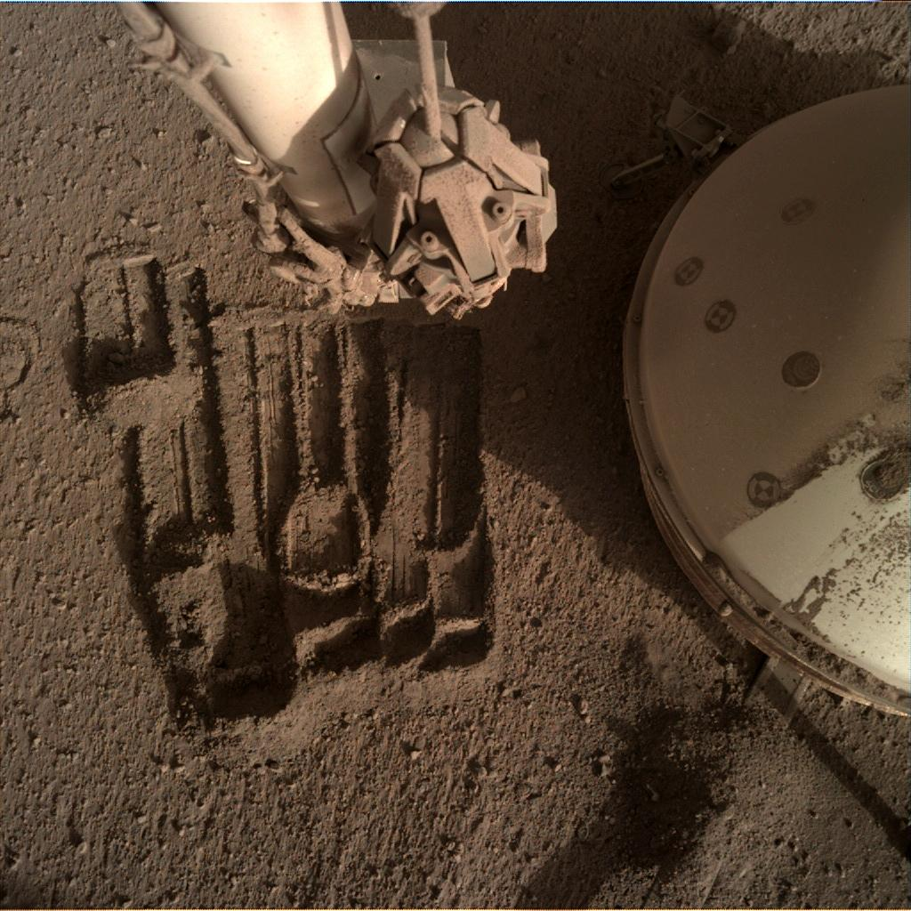 Nasa's Mars lander InSight acquired this image using its Instrument Deployment Camera on Sol 932