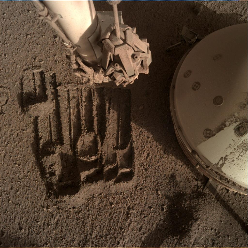 Nasa's Mars lander InSight acquired this image using its Instrument Deployment Camera on Sol 936