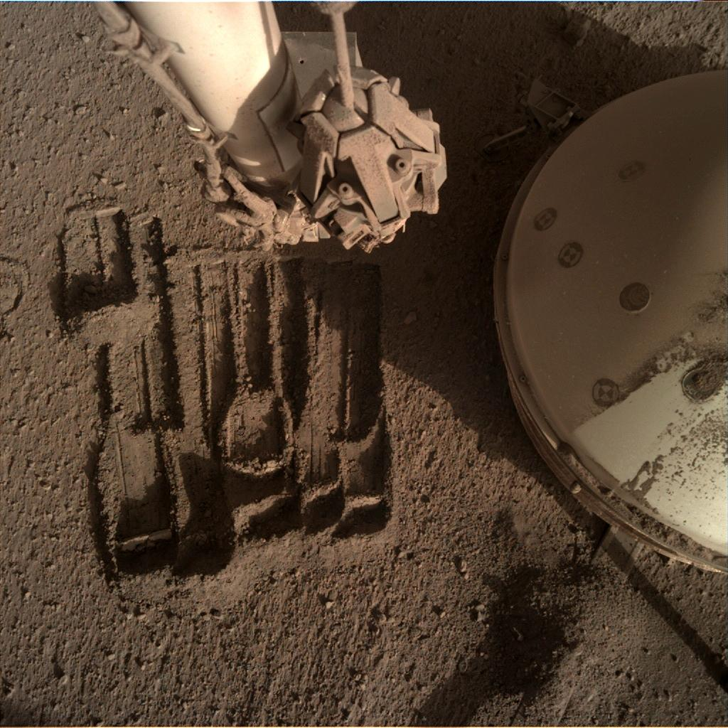 Nasa's Mars lander InSight acquired this image using its Instrument Deployment Camera on Sol 939
