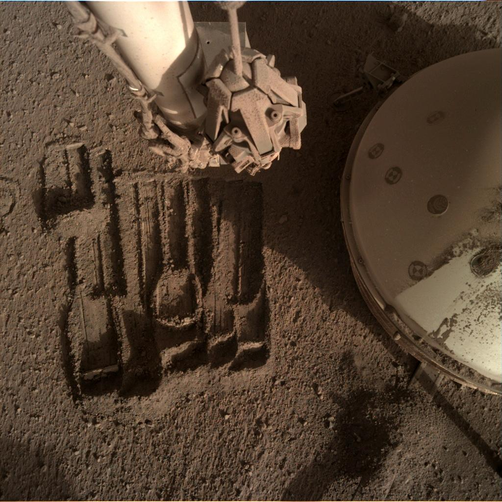 Nasa's Mars lander InSight acquired this image using its Instrument Deployment Camera on Sol 946