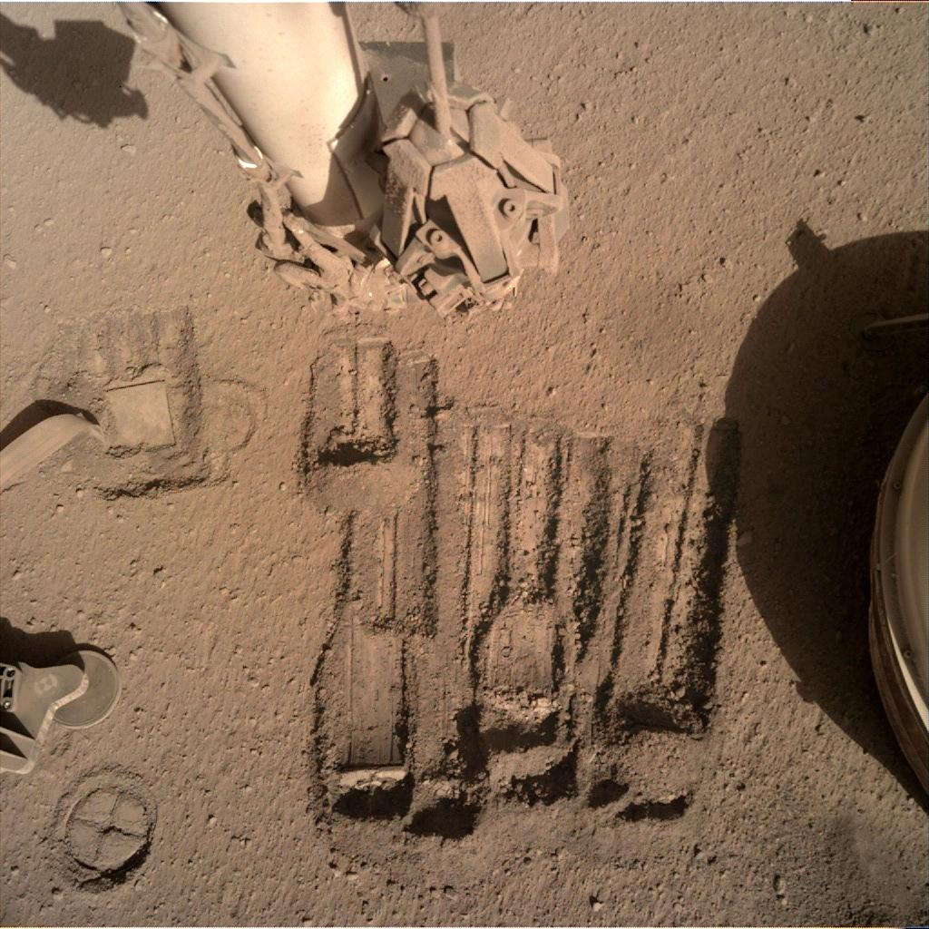 Nasa's Mars lander InSight acquired this image using its Instrument Deployment Camera on Sol 952