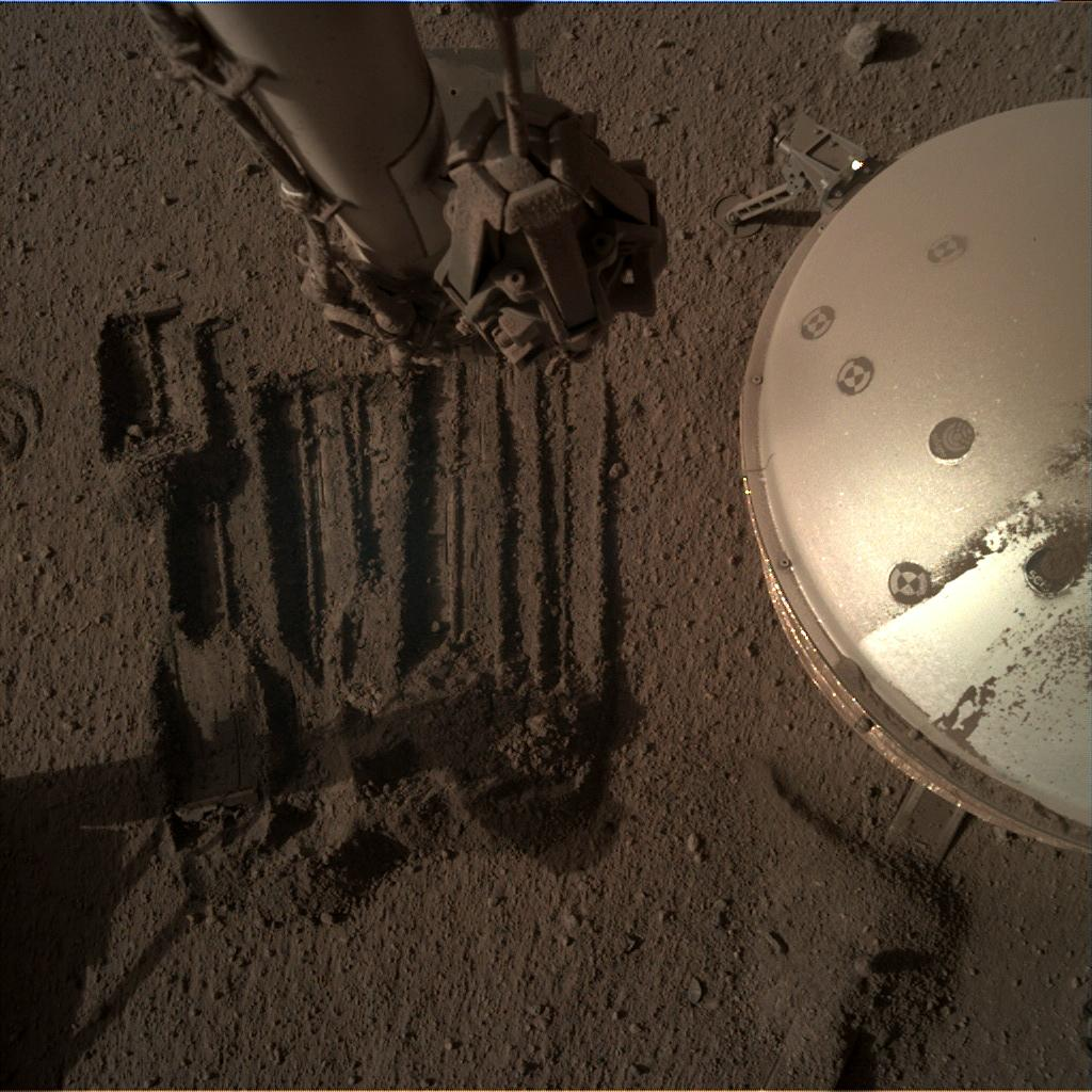 Nasa's Mars lander InSight acquired this image using its Instrument Deployment Camera on Sol 966