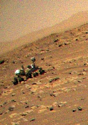 Zoomed in version of Mars Helicopter imaging the Perseverance rover.
