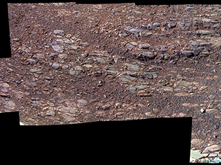"This enhanced-color view of ground sloping downward to the right in ""Perseverance Valley"""