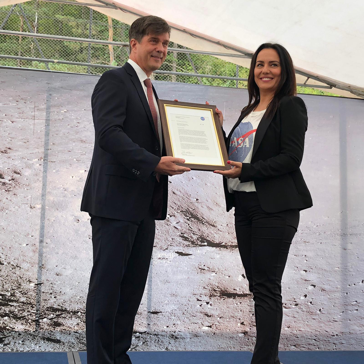 Eric Nelson, the U.S. Ambassador to Bosnia and Herzegovina, presents a framed letter to the Snezana Ružičić, mayor of the Balkan municipality of Jezero. The letter, from NASA's director of Mars Exploration, James Watzin, honored the connection between the small Balkan town and Jezero Crater the landing site of NASA's upcoming Mars 2020 mission.