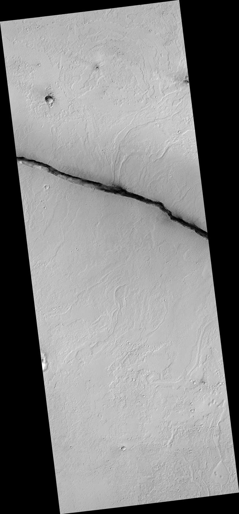 The linearity of the volcanic vent shown in this HiRISE image, in conjunction with evidence of lava flow from the vent, suggests control by combined volcano-tectonic processes. The details of this vent gained by HiRISE should provide insight into those volcano-tectonic processes along Cerberus Fossae fissures in two ways.