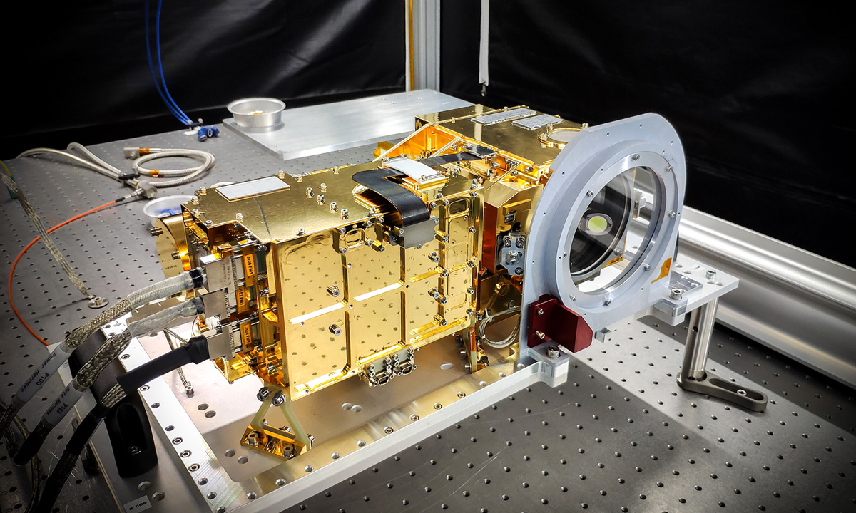 The SuperCam instrument is shown on a laboratory table before being installed on the rover.