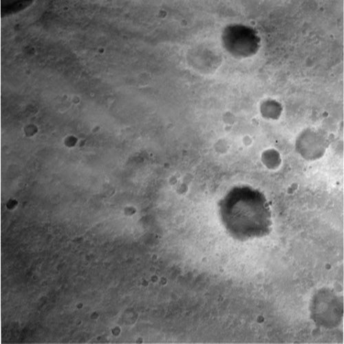 This black and white image shows the pockmarked martian surface that Spirit encountered on its descent to Gusev Crater. The picture is taken at an altitude of 1,433 meters (about 4,701 feet). These images help the onboard software to minimize the lander's horizontal velocity before its bridle is cut, and it falls freely to the surface of Mars.