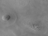 The team operating the Context Camera (CTX) aboard NASA's Mars Reconnaissance Orbiter frequently discovers new dark spots on Mars that, upon closer examination, turn out to be brand new impact craters.