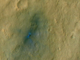 This color-enhanced view of NASA's Curiosity rover on the surface of Mars was taken by the High Resolution Imaging Science Experiment (HiRISE) on NASA's Mars Reconnaissance Orbiter as the satellite flew overhead.