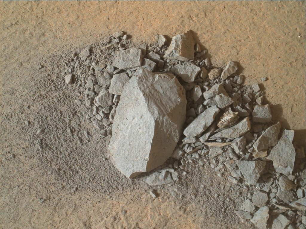 "MAHLI view of the ""chunk"" of rock dislodged by the mini-drill activity"
