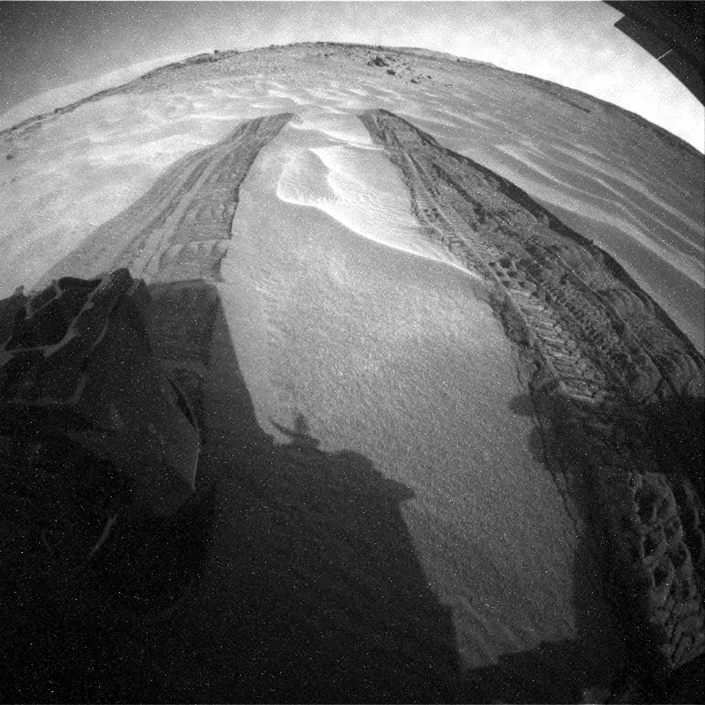 NASA's Mars rover Curiosity acquired this image using its Rear Hazard Avoidance Cameras (Rear Hazcams) on Sol 710