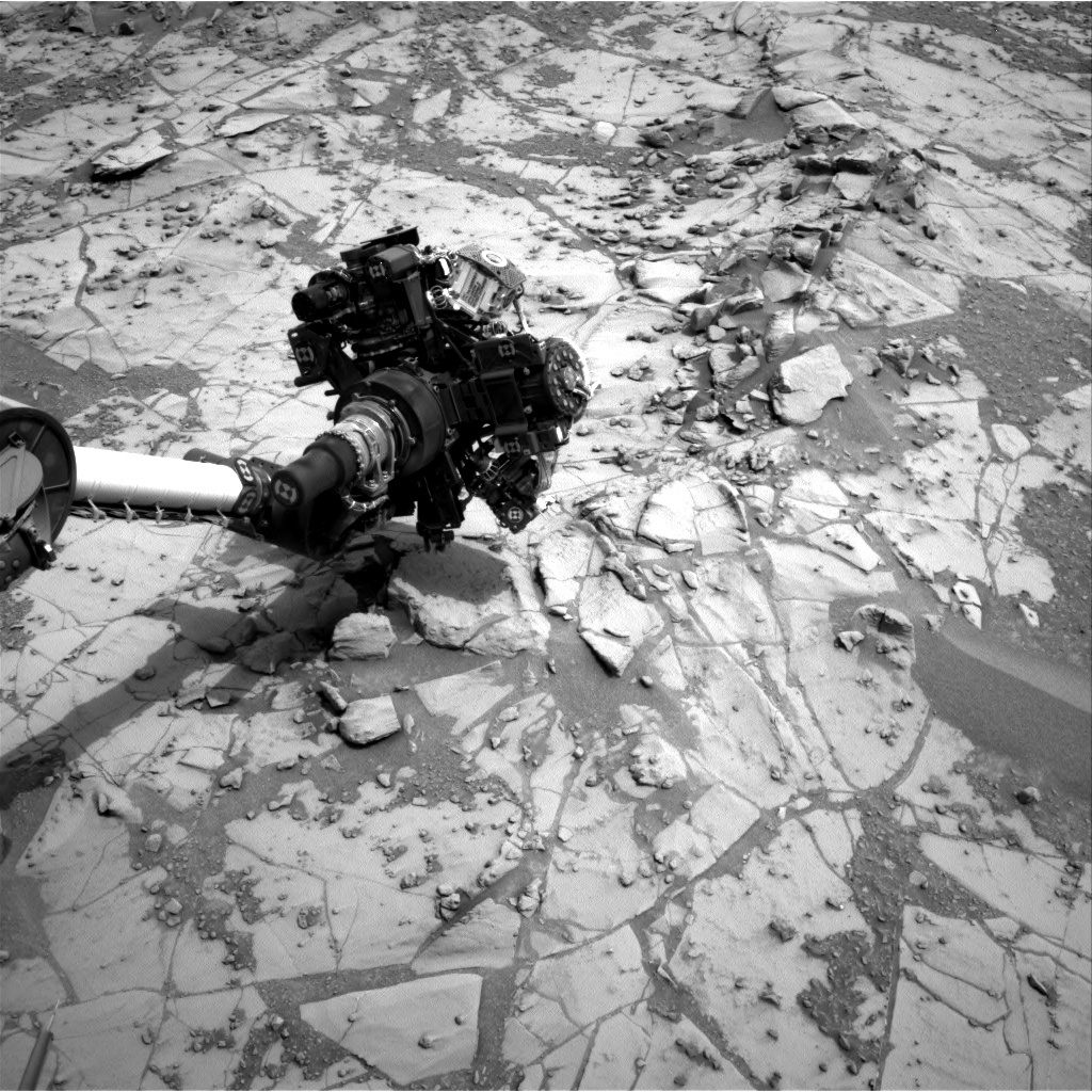 Navcam image showing Curiosity's arm outstretched, doing contact science.