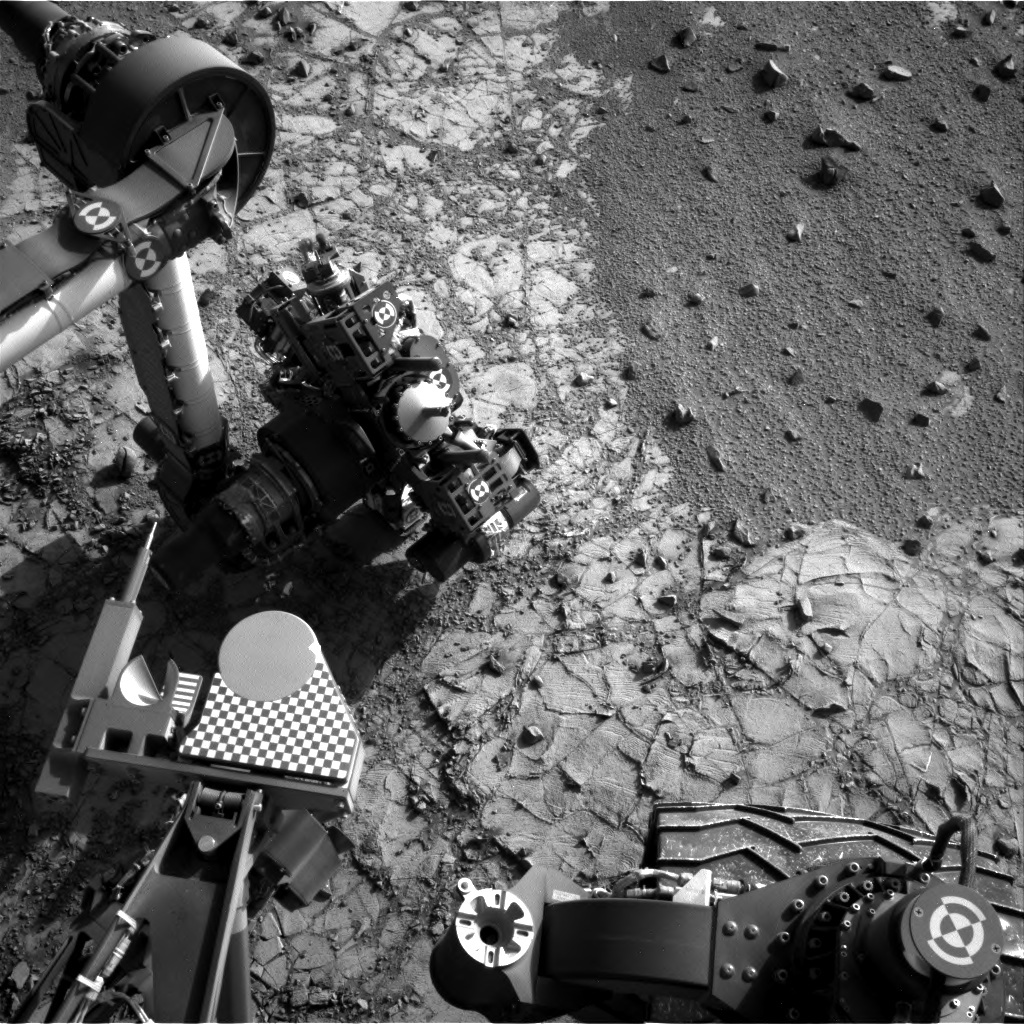Navcam image of the arm with APXS placed on the drill tailing pile.