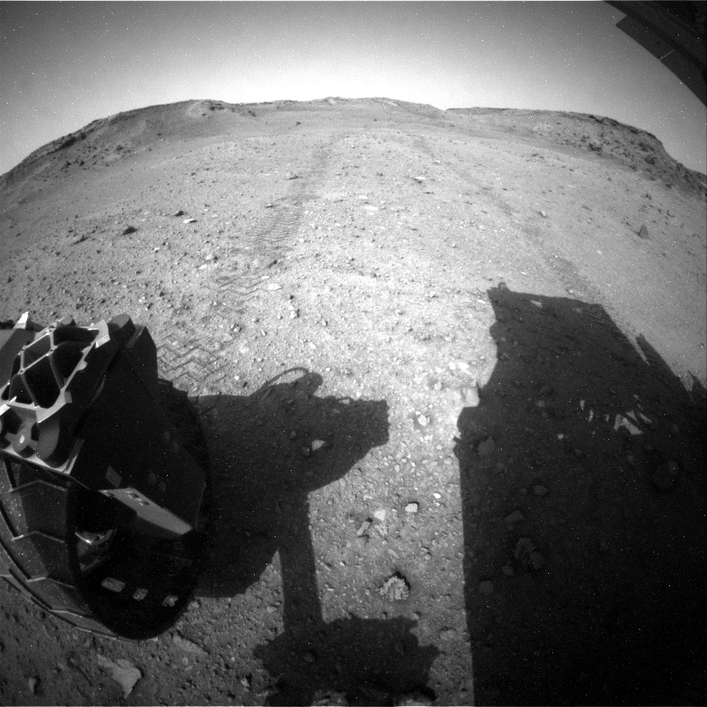 Rear hazcam view of the rover's tracks as we leave Shoshone quad.