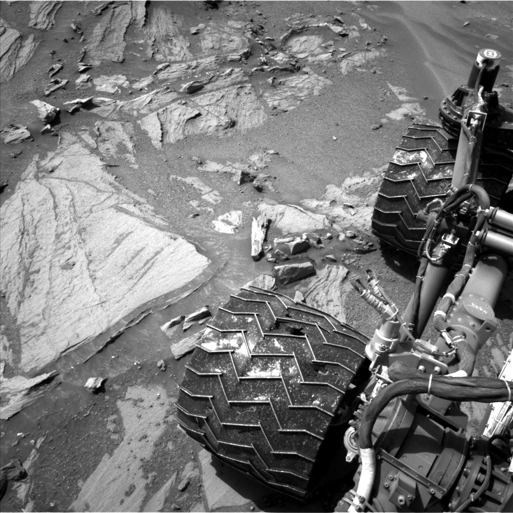View of the rover wheels after a 35 m drive.