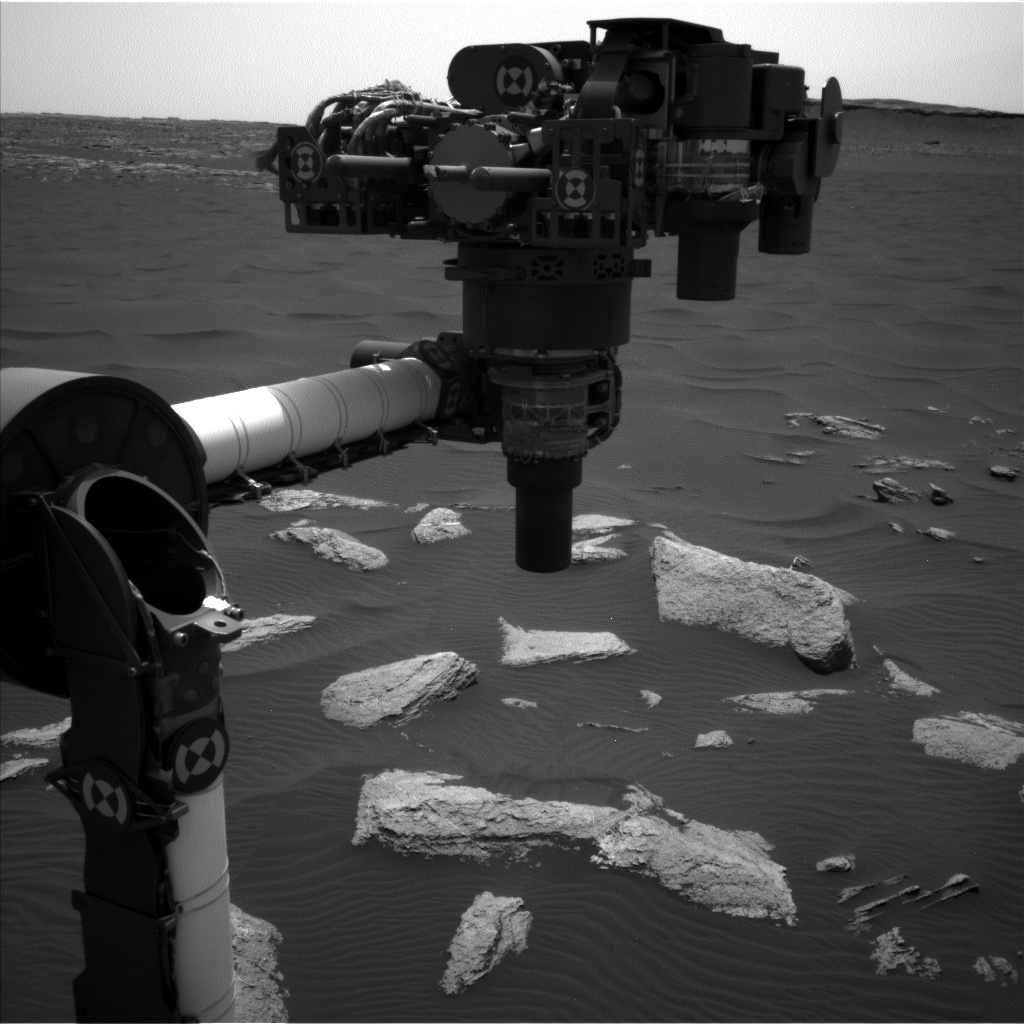 "Curiosity's arm in the ""ready out"" position"