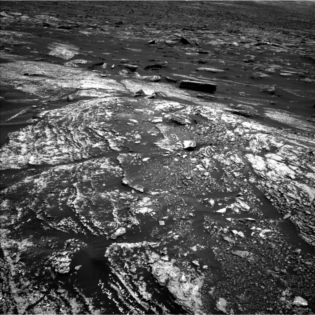 Navcam of interesting layered rocks in front of the rover