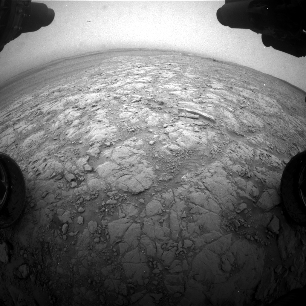 Nasa's Mars rover Curiosity acquired this image using its Front Hazard Avoidance Camera (Front Hazcam) on Sol 2102, at drive 1818, site number 71
