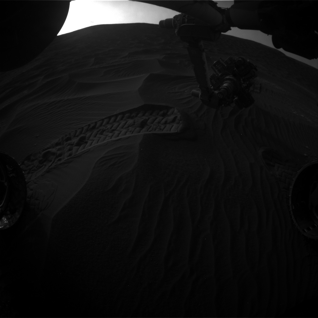 Nasa's Mars rover Curiosity acquired this image using its Front Hazard Avoidance Camera (Front Hazcam) on Sol 2409, at drive 1564, site number 75