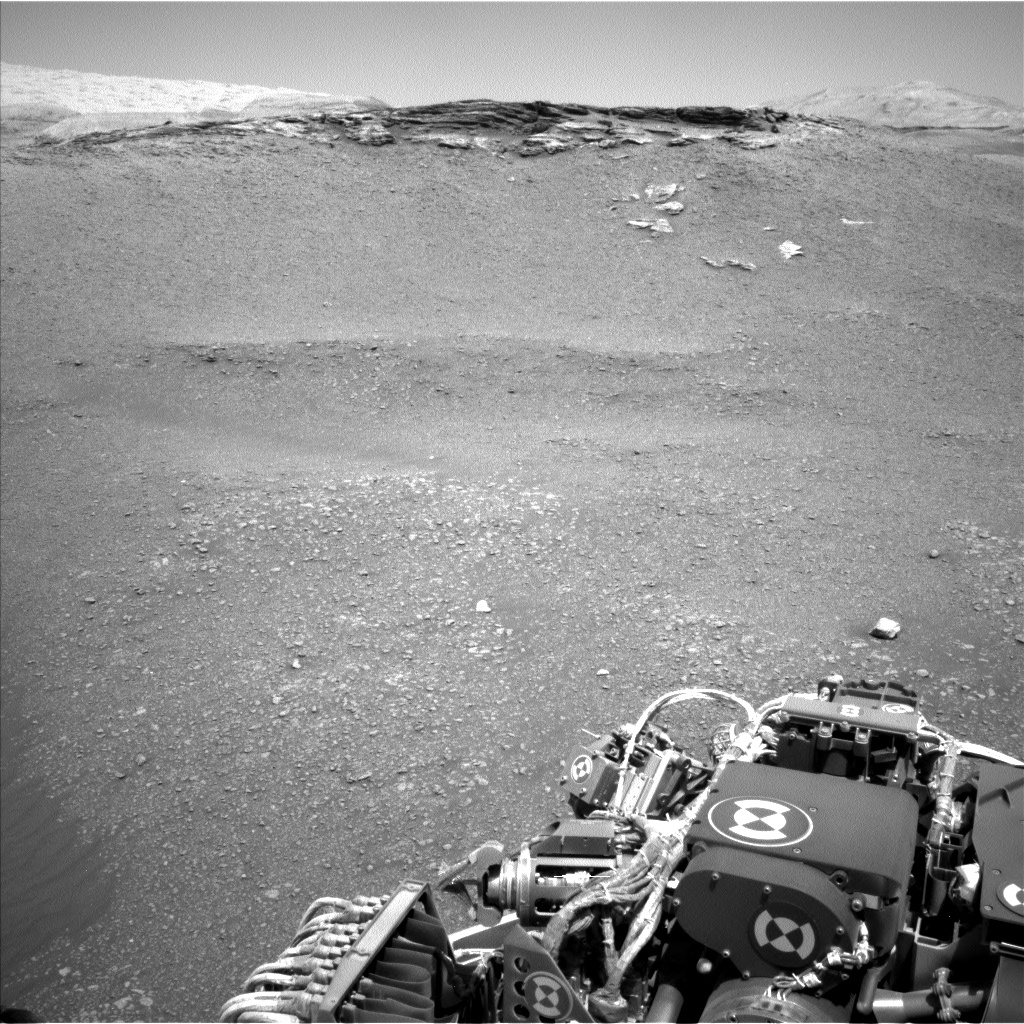 Sols 2437-2439: An oasis of rock in a sea of pebbles