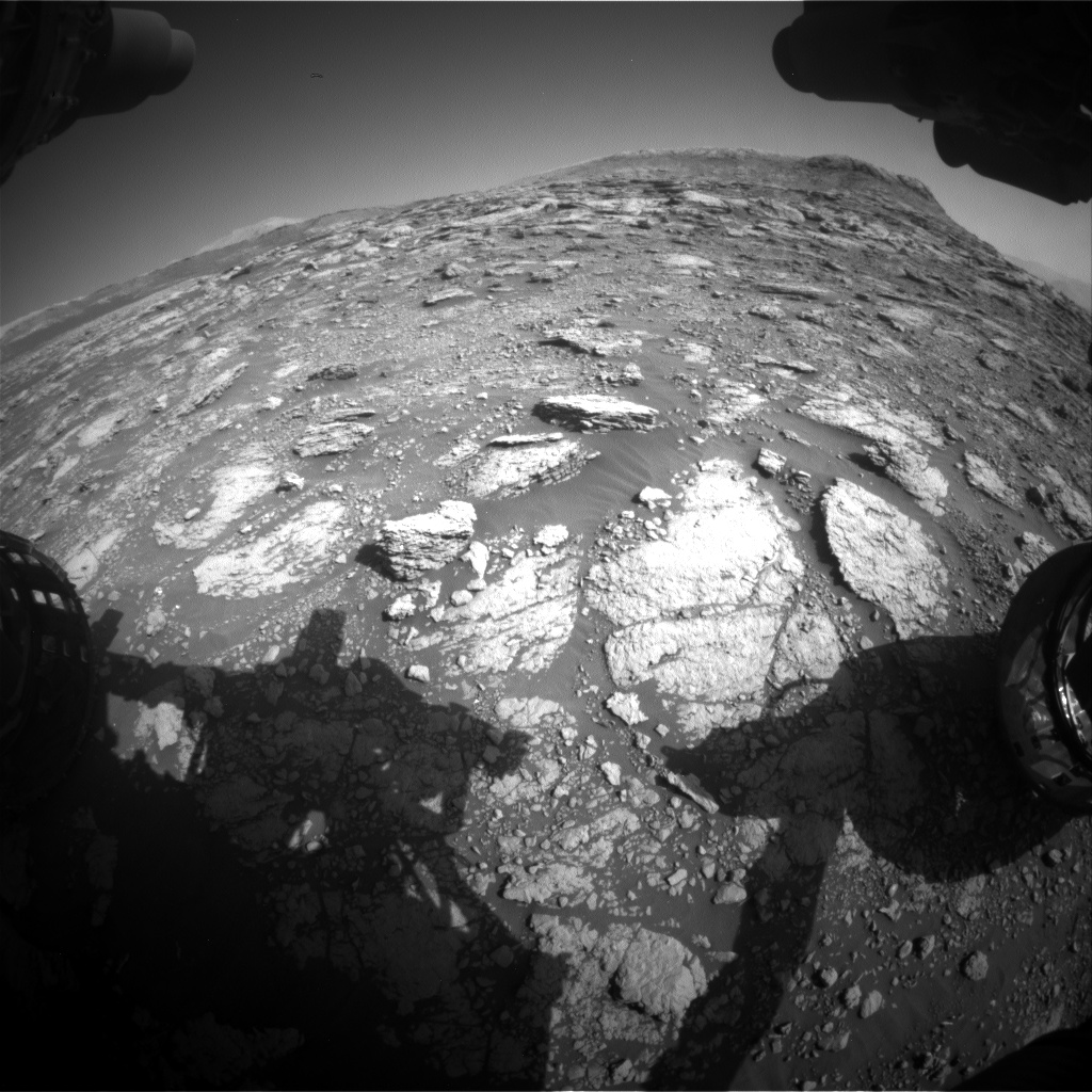 Nasa's Mars rover Curiosity acquired this image using its Front Hazard Avoidance Camera (Front Hazcam) on Sol 2569, at drive 910, site number 77
