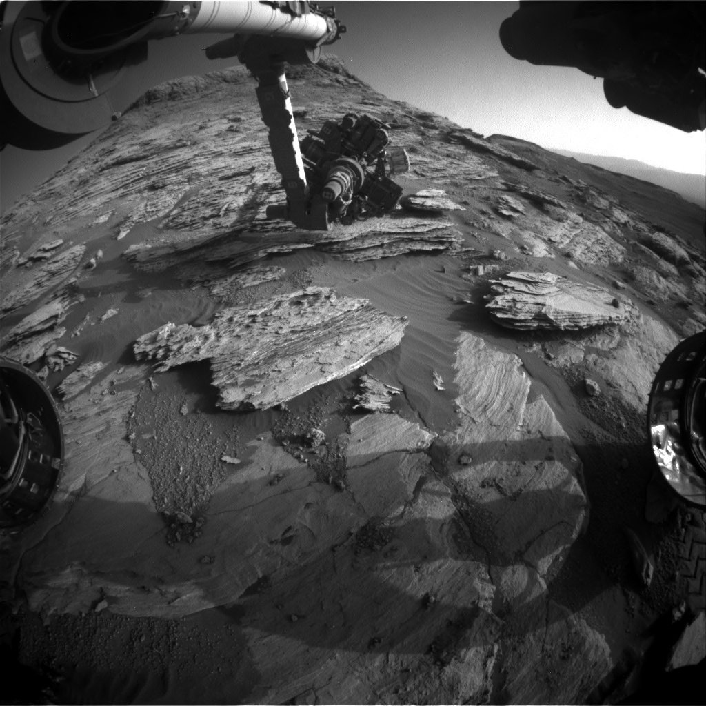 Nasa's Mars rover Curiosity acquired this image using its Front Hazard Avoidance Camera (Front Hazcam) on Sol 2581, at drive 1560, site number 77
