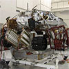 These three images show the progression of 'stacking' the Mars Science Laboratory rover and its descent stage in one of the Jet Propulsion Laboratory's 'clean room.' The final image shows the two pieces on top of each other.