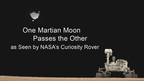 see the image 'One Martian Moon Passes the Other'