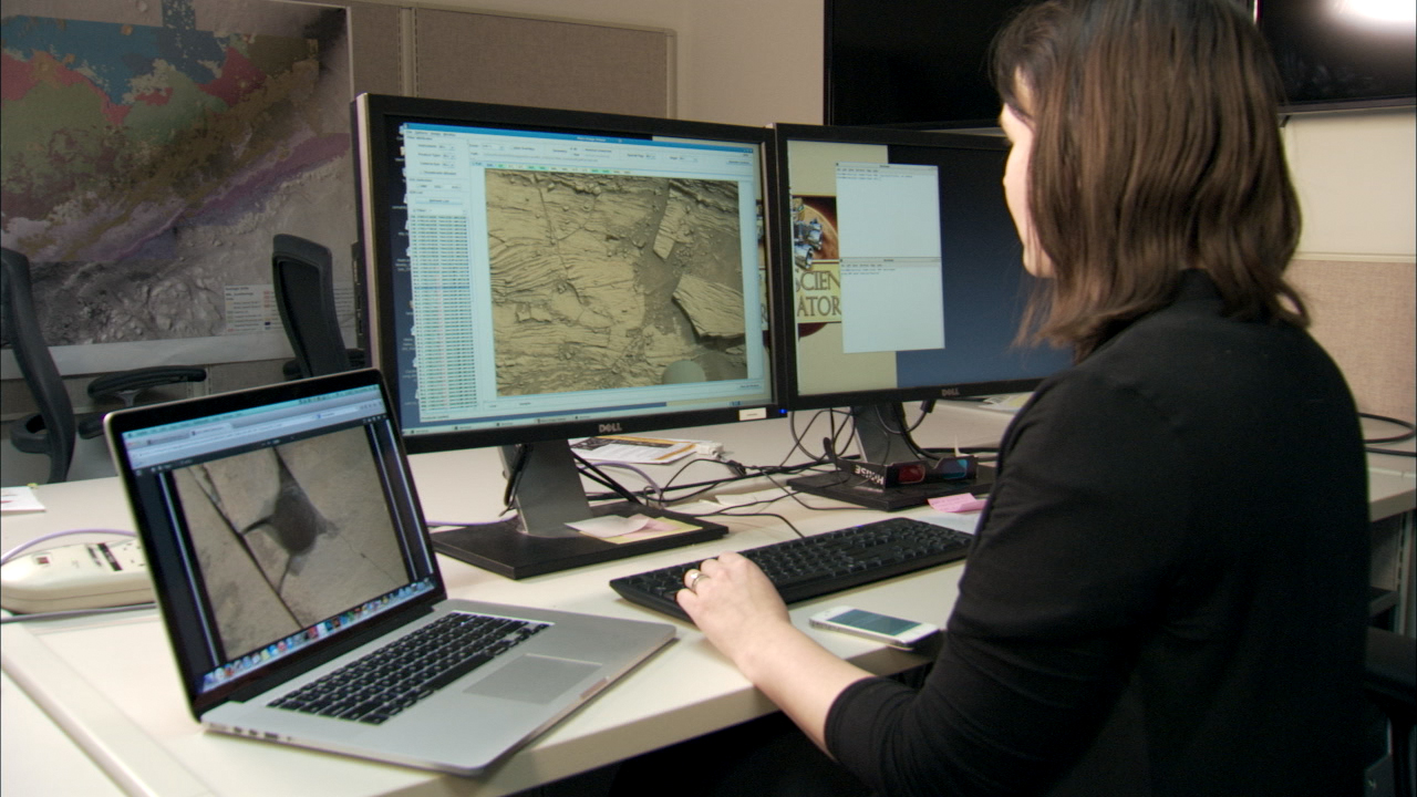 Mission Scientist Examines Mars Images On Her Computer