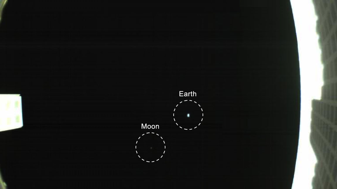 slide 5 - This image taken by NASA's Mars Cube One (MarCO) CubeSats contains a photograph of Earth and Mars at a distance.