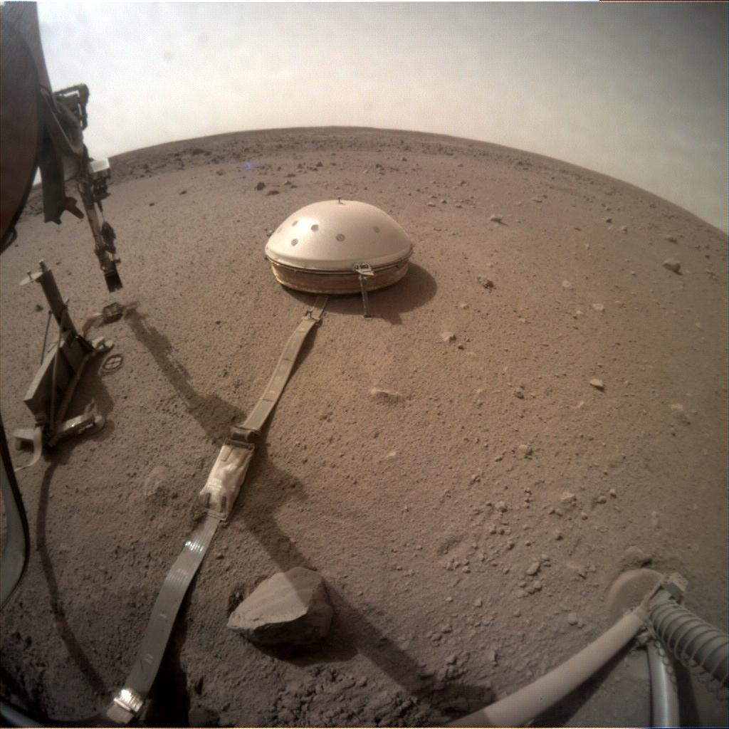 slide 2 - Image of InSight's seismometer and heat probe.