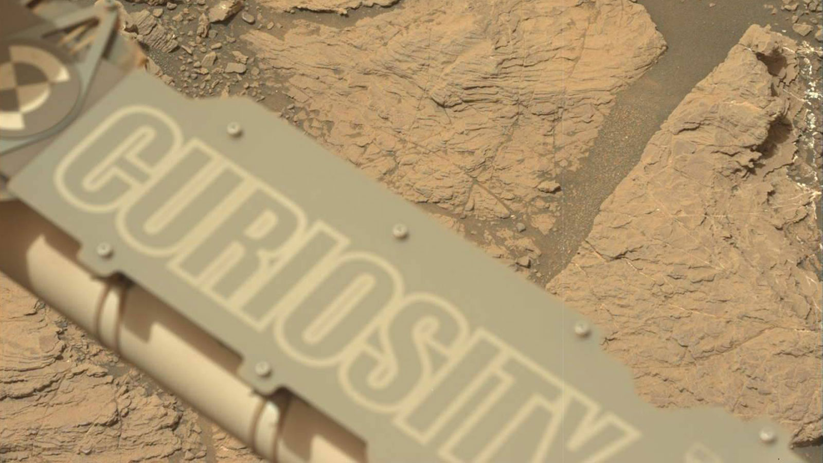 "slide 4 - NASA's Curiosity Mars took this image with its Mastcam on Feb. 10, 2019 (Sol 2316). The rover is currently exploring a region of Mount Sharp nicknamed ""Glen Torridon"" that has lots of clay minerals."