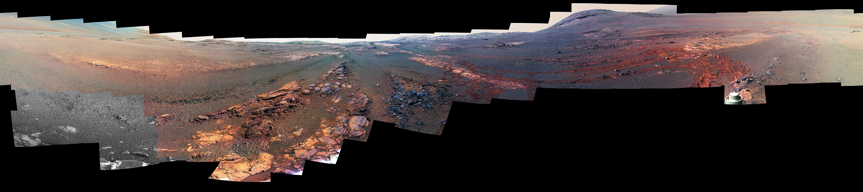 slide 3 - This image is a cropped version of the last 360-degree panorama taken by the Opportunity rover's Panoramic Camera (Pancam) from May 13 through June 10, 2018. The view is presented in false color to make some differences between materials easier to see.